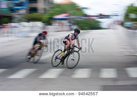 Motion Blur Of Teen Cyclist Racing In Athens Twilight Criterium