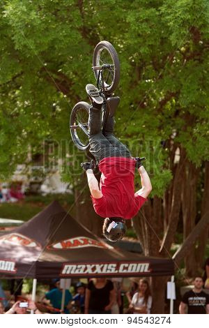 BMX Pro Gets Upside Down Performing Trick In Competition