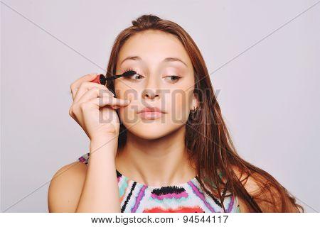 Beautiful Young Woman Applying Mascara.
