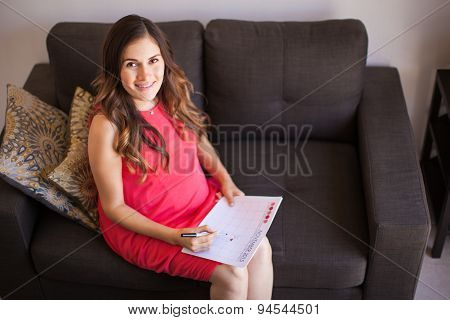 Pregnant Woman With Calendar