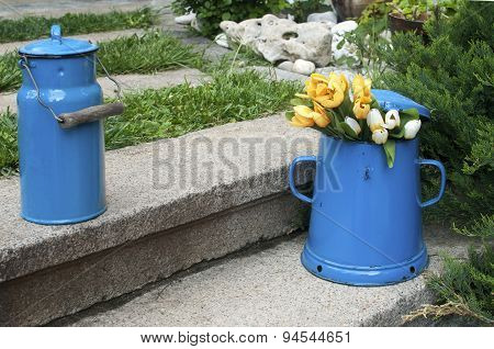Blue enamel jugs on stone steps