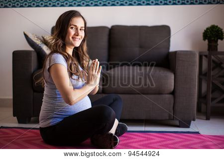 Happy Pregnant Woman Doing Yoga