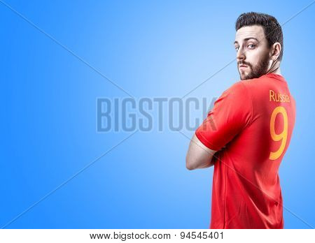 Russian soccer player on blue background