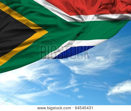 South African waving flag on a beautiful day