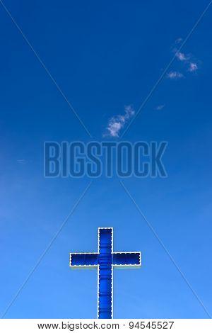 Blue Cross On Clear Blue Sky.