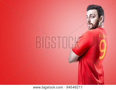 Russian soccer player on red background