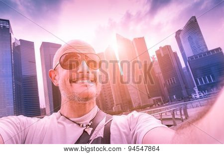Handsome Man Taking Adventure Selfie At Modern Urban Area Of Marina Bay In Singapore At Sunset