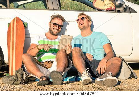 Young Hipster Best Friends Having Fun With Tablet During A Car Trip Moment - Concept Of Modern Tech
