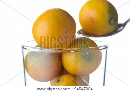 Small Oranges In The Glass