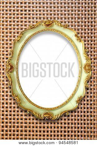 Vintage golden frame on woven background