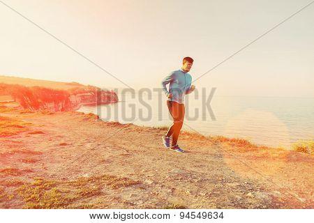 Man Running On Shore At Sunny Day