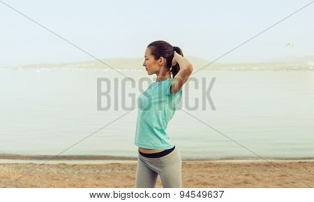 Beautiful Young Woman Workout On Beach