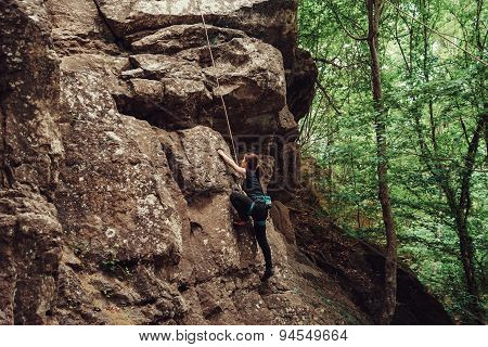 Sporty Young Woman Climbing Outdoor