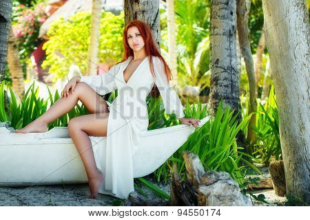 Young Beautiful Girl In White Dress On A Tropical Island.