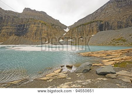 Icy Alpine Lake In The Fall