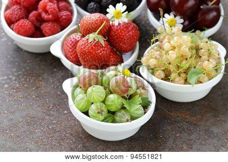 Assorted summer berries (raspberries, strawberries, cherries, currants, gooseberries)