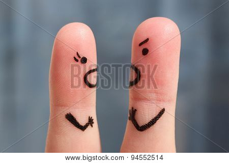 Finger art of a couple during quarrel. The concept of a man and woman yelling at each other.