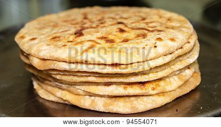 Sattu Paratha ~ Stacked Indian bread with stuffed powdered roasted gram &  pickle gravy