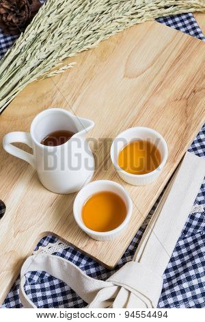 Wood Texture Cutting Plate With Cups Of Tea