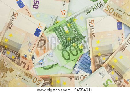 Euro banknotes scattered on the table. Background made with valid euro banknotes.