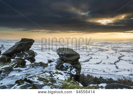 Stunning Winter Sunset Over Countryside Landscape With Dramatic Sky And Clouds