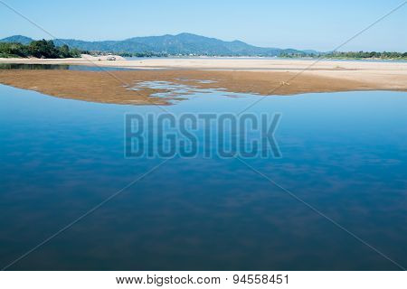 Sandbank Of River In Water Foreground
