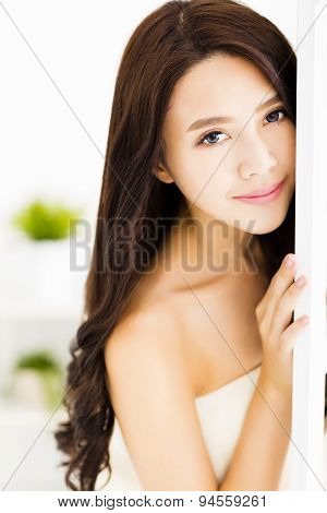 Beautiful young woman looking and smiling