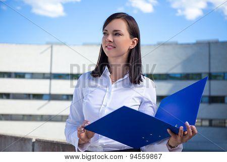 Beautiful Business Woman Holding Blue Folder