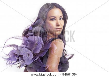 Latin Woman With Blowing Hair Double Exposure With A Hortensia's Flowers