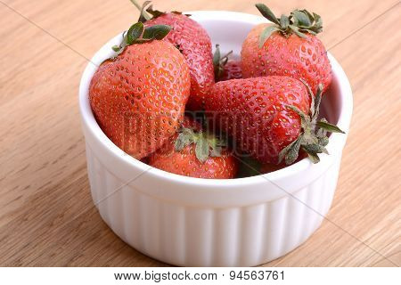 Close Up Strawberry On Wooden Plate