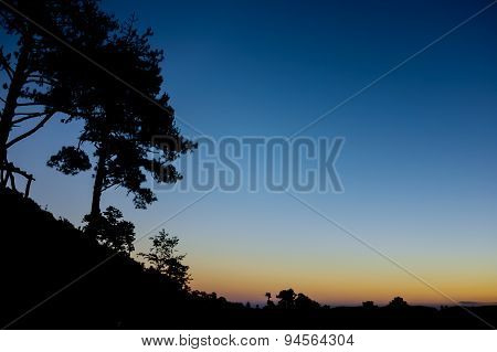 Clear Blue Sky After Sunset Which Looking From A Silhouetted Mountain