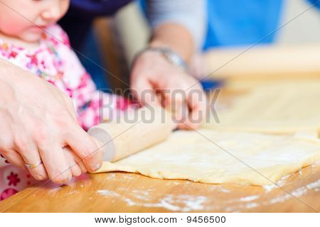 Closeup Of Family Baking Pie
