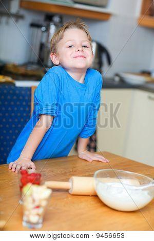 Boy helping at kitchen