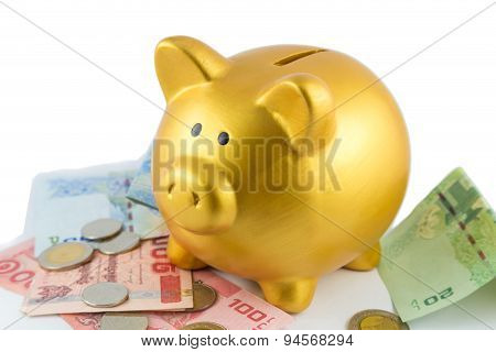 Piggy Bank In Gold Color On Bank And Coin