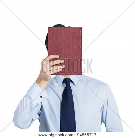 A Person Holds A Red Book In Front Of The Head. Isolated.