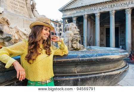 Smiling Woman Tourist Leaning On The Pantheon Fountain In Rome
