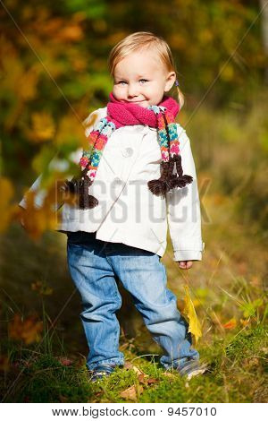 Toddler Girl In Autumn Forest