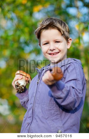Happy Boy With Wild Mushrooms