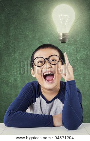 Smart Child With A Bright Lamp