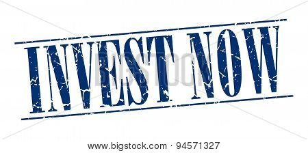 Invest Now Blue Grunge Vintage Stamp Isolated On White Background