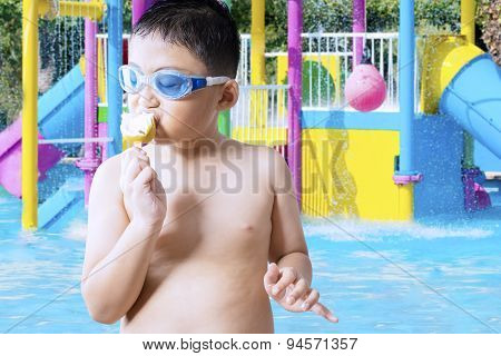 Small Boy Eating Ice Cream At Pool