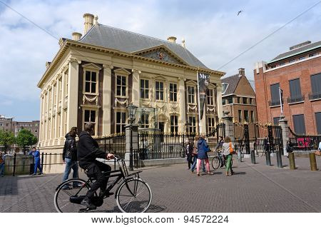 The Hague, Netherlands - May 8, 2015: Tourists Visit Mauritshuis Museum In The Hague, Netherlands.
