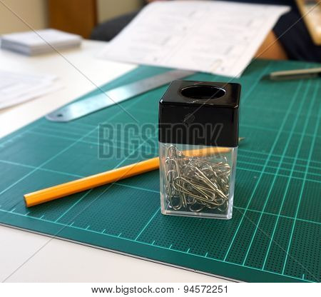 Office Supplies Such As Pencil, Clip And The Rubber Pad