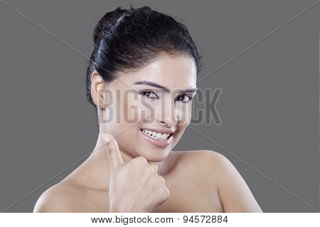 Woman With Clean Skin Showing Thumb Up