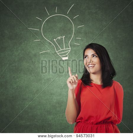 Woman Pointing At A Picture Of Lamp
