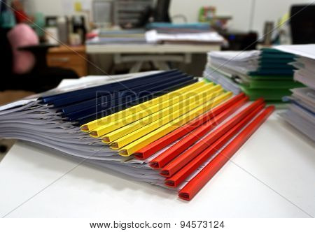 Stack Of Colorful Folders On The Table