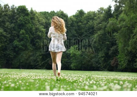 Portrait in full growth, Young beautiful blonde woman walking away