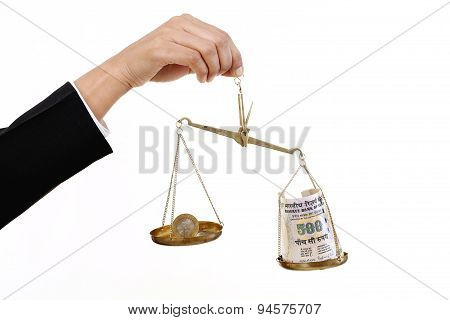 Rupee Coin And Indian Currency Notes In Justice Scale