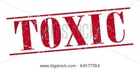 Toxic Red Grunge Vintage Stamp Isolated On White Background