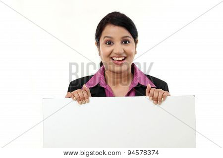 Cheerful Business Woman Showing Blank Signboard